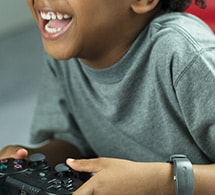 Kid playing video games while wearing actiwatch